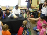 Children come up to meet the puppets after a show.